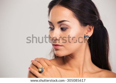 Jewelry concept. Closeup portrait of gorgeous woman posing isolated on a white background.  - stock photo