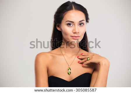 Jewelry concept. Gorgeous female model looking at camera isolated on a white background - stock photo