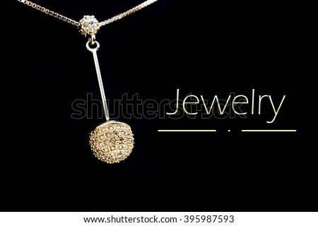 jewelry pendant on a black background - stock photo