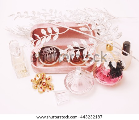 Jewelry table with lot of girl stuff on it, little mess in cosmetic brushes, women interior concept, perfume elegance things - stock photo