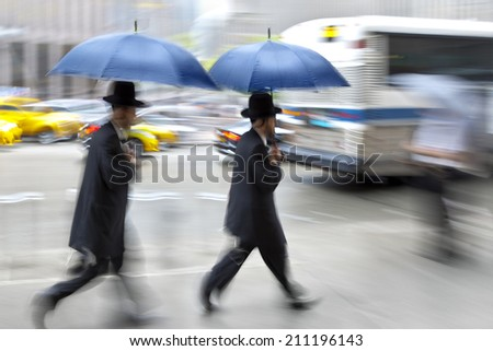 Jewish abstract image of business people in the street and modern style with a blurred background - stock photo