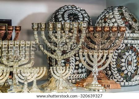 Jewish holiday Hanukkah of silver in the souvenir shop . - stock photo