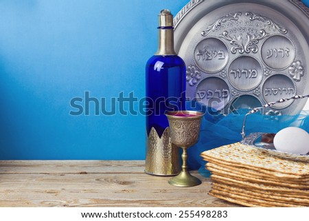 Jewish holiday Passover background with matzo and wine - stock photo