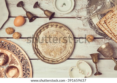Jewish holiday Passover background with vintage plate. View from above. Flat lay - stock photo