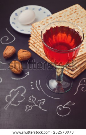 Jewish holiday Passover celebration with matzo and wine on chalkboard - stock photo