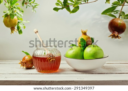 Jewish holiday Rosh Hashana (new year) background with honey jar, apples and pomegranate tree - stock photo