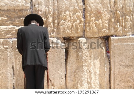 Jewish man at the wailing wall jerusalem prayer - stock photo