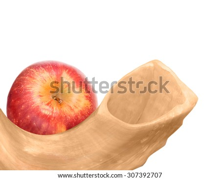 Jewish New Year holiday traditional religious ritual object and food. Rosh Hashana shofar and ripe whole red apple, top down view. Isolated on a white background. Copyspace.  - stock photo