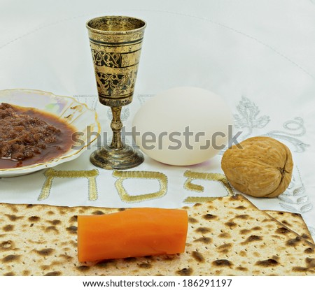 Jewish Passover holiday traditional food set placed on a white festive serviette with Hebrew word -  Passover - stock photo