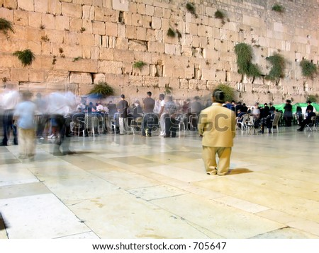 Jews are praying in front of the wailing wall in Jerusalem israel - stock photo