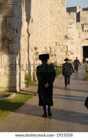 Jews heading to the Western Wall on Shabbat - stock photo