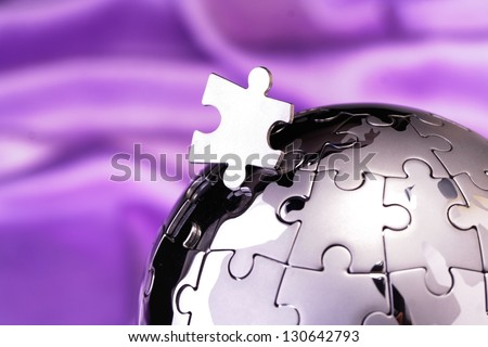 Jigsaw globe puzzle - stock photo