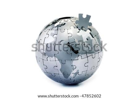 Jigsaw globe puzzle on white - stock photo
