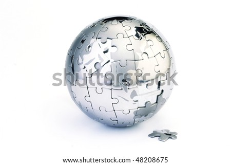 Jigsaw globe puzzle on white - stock photo