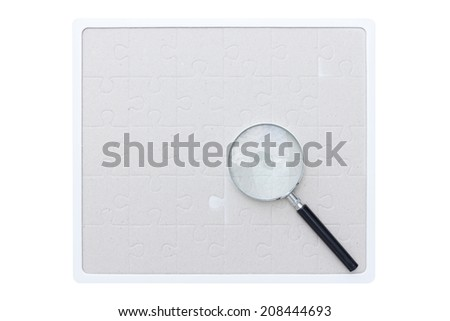 jigsaw missing searching by magnifying glass isolate on white background with clipping path - stock photo