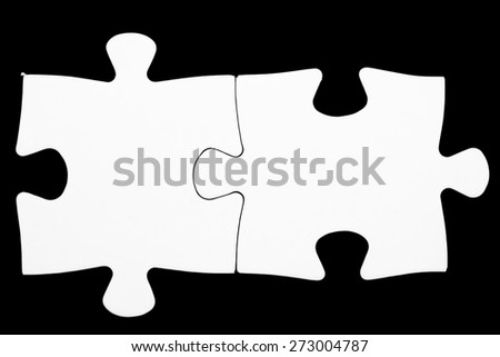 Jigsaw pieces isolated on black Jigsaw and puzzles concepts - stock photo