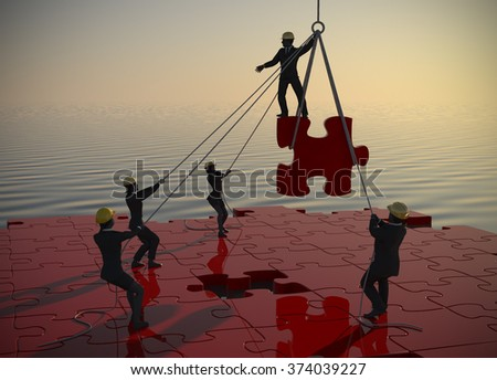 Jigsaw puzzle being built by teamwork at dawn by the sea. A great jigsaw puzzle being built by a successful team at dawn by the sea. - stock photo