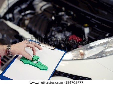 jigsaw puzzle car solve problem - stock photo