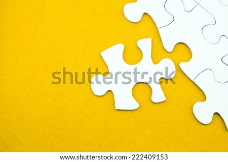 Jigsaw puzzle on recycle paper  for business concepts such as sucess, problem solution, idea, teamwork etc. - stock photo