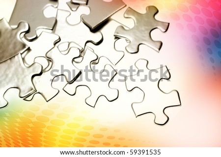 Jigsaw puzzle pieces on color background - stock photo