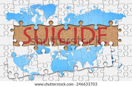 Jigsaw puzzle reveal suicide word behind - stock photo
