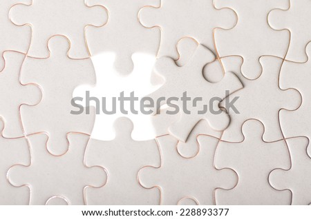 jigsaw puzzle with missing piece concept of finding solution and success - stock photo