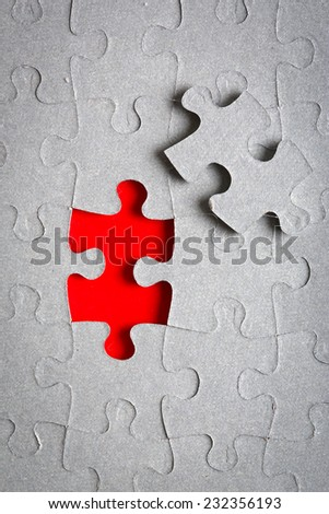 Jigsaw puzzle with missing pieces - stock photo