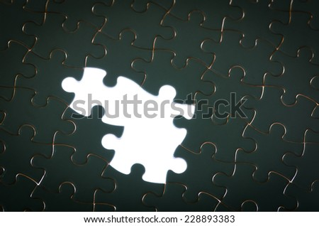 jigsaw puzzle with missing pieces concept of incomplete task - stock photo