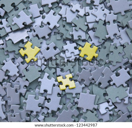 jigsaw puzzle with three yellow tiles - stock photo