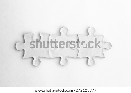 Jigsaw Puzzles Piece on white  - stock photo