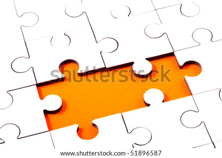 Jigsaw With Pieces Missing Revealing Orange Background - stock photo