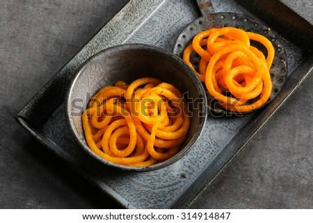 Jilebi / Indian sweet -rustic moody shot, selective focus - stock photo
