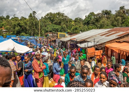 JIMMA, ETHIOPIA - MAY 2, 2015 : Popular and crowded african market in Jimma, Ethiopia with many  people buying and selling. - stock photo