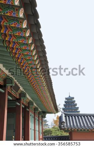 Jipgyeongdang Hall at the Gyeongbokgung Palace with on the background the pagoda at the National Folk Museum of Korea  - stock photo