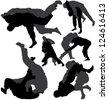 Jiu-Jitsu and Judo wrestlers silhouettes. Raster version. - stock photo