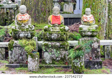 Jizo statues in Okunoin cemetery in Koyasan, Japan. Jizo is a Bodhisattva, an enlightened follower of Buddhism. He is most famously known as the protector of children.  - stock photo