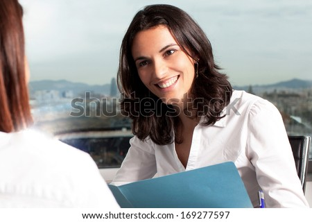 job interview by a woman in board room - stock photo