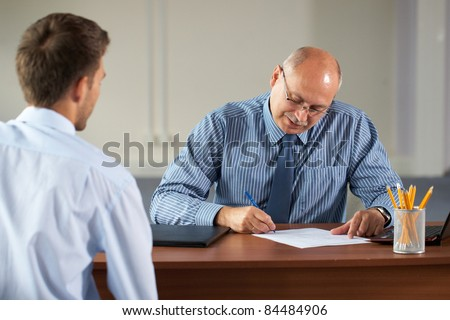 job interview, senior manager and young apprentice isolated on white background - stock photo