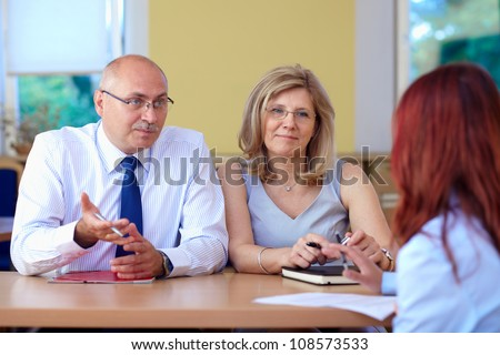 Job interview, two senior colleagues from hr department and young applicant - stock photo