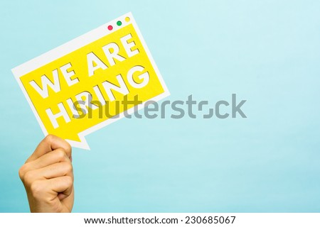 Job message board blue background with empty space. We are hiring yellow banner. Business concept. - stock photo
