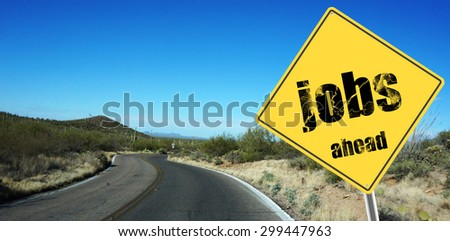 Jobs ahead sign on a sky background and dessert road - stock photo