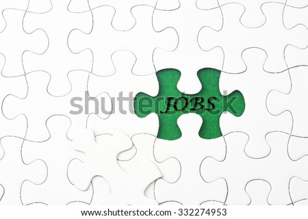 JOBS word at missing puzzle  - stock photo