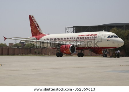 JODHPUR, INDIA - 25 April, 2015. Air India Airbus A319 aircraft in Jodhpur Airport as it is starting its engines for flight to Delhi.  - stock photo