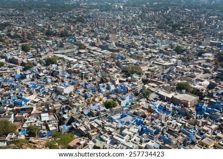 JODHPUR, INDIA - JAN 28: Aerial cityscape of old colorful buildings city in Rajasthan state on January 28, 2015. Jodhpur, with population 1,290,000 people, is a center of Marwar region of India - stock photo