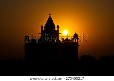 Jodhpur, Rajasthan, India- The sun rises behind the Jaswant Mausoleum silhouetting the temple.  - stock photo