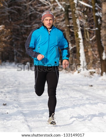 jogger in the winter - stock photo