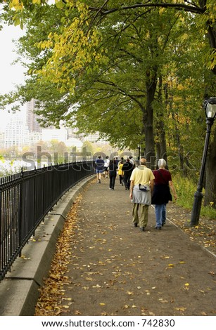 Joggers and walkers around the reservoir, central park, Manhattan, New York, America, USA - stock photo