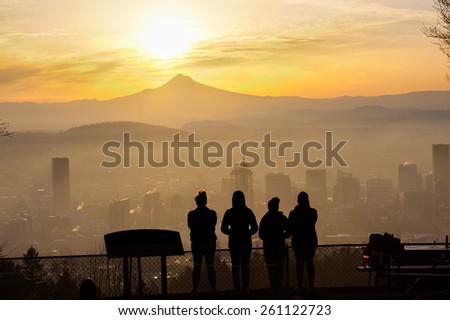Joggers taken in the view after reaching Pittock Mansion - stock photo