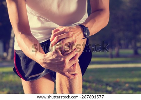Jogging injury. Warp up before any exercise. - stock photo