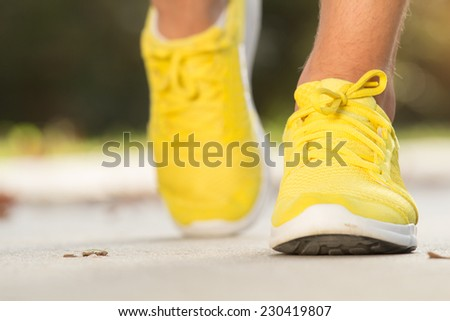 Jogging sneakers detail. Shallow depth of field. - stock photo